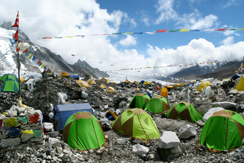Colorful tents and Tibetan prayer flags at Everest Base Camp, Khumbu Region, Nepal.
